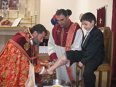 Bishop Sebouh Chouldjian of the Armenian Apostolic Church washing the feet of children. Bishop Sebouh - Washing of Feet.jpg