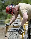 Bond beam work at Gabriela Mistral School construction site 150622-F-LP903-780.jpg