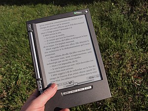 E Ink - iLiad e-book reader equipped with an e-paper display visible in the sunlight