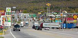 The stretch of U.S. Route 30 in Breezewood, Pennsylvania is one of the few gaps in the Interstate Highway System. A portion of I-70 uses this surface street to connect the untolled interstate highway with the Pennsylvania Turnpike.