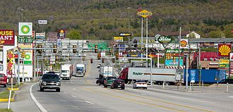 Breezewood, Pennsylvania - The  stretch of U.S. Route 30 in Breezewood, Pennsylvania is one of the few gaps in the Interstate Highway System. A portion of I-70  uses this surface street to connect the non-tolled interstate highway with the Pennsylvania Turnpike.