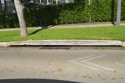 Saltwater in drain on a bayfront street (Brickell Bay Drive) in Miami just up to street level; while not a direct flood, this inhibits normal passive, gravity-based drainage. Brickell Bay Drive drain at threshold of flooding during king tide 2016.jpg