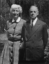Photo of an aged Brown and his wife, taken outdoors, both standing up and dressed nicely