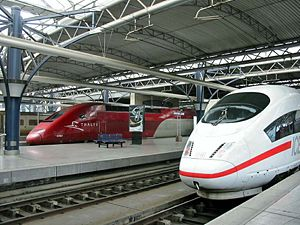 Transport in Europe - A German ICE 3, a French Thalys and a French-British Eurostar at Brussels South railway station.