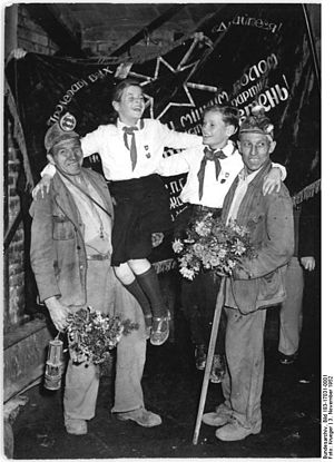 The Banner of Krivoi Rog - Miners and pioneers pose in front of the Banner of Krivoi Rog. 1952.