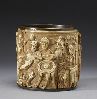 Hesperides - This circular Pyxis or box depicts two scenes.  The one shown presents the Olympian gods feasting around a tripod table holding the golden Apple of the Hesperides. The Walters Art Museum.