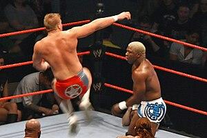 Lance Cade - Cade leaps to deliver a dropkick to Shelton Benjamin.