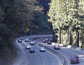 "California State Route 17 - Looking downhill from the Summit Road overpass; brake lights can be seen as cars slow down before the curve known as ""The Valley Surprise""."