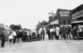 Car rally participants in the street outside the Grand Hotel Mount Morgan ca. 1925.tiff