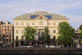 Royal Theater Carré Theatre in Amsterdam, located near the river Amstel