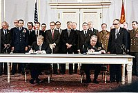 Carter and Brezhnev sign the SALT II treaty, 18 June 1979, in Vienna
