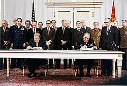 President Jimmy Carter and Soviet General Secretary Leonid Brezhnev sign the Strategic Arms Limitation Talks (SALT II) treaty, June 18, 1979, in Vienna.