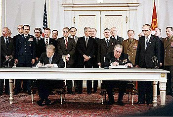 President Jimmy Carter and Soviet General Secretary Leonid Brezhnev sign the Strategic Arms Limitation Talks (SALT II) treaty, 16 June 1979, in Washington D.C.  Zbigniew Brzezinski is directly behind President Carter and is the only person smiling in the picture.