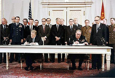 Carter and Brezhnev sign the SALT II treaty, 18 June 1979, in Vienna Carter Brezhnev sign SALT II.jpg