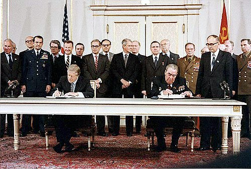 Jimmy Carter and Leonid Brezhnev signing the SALT II treaty, June 18, 1979, at the Hofburg Palace in Vienna. Carter Brezhnev sign SALT II.jpg