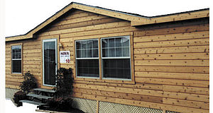 Exterior of a manufactured home showing cedar ...