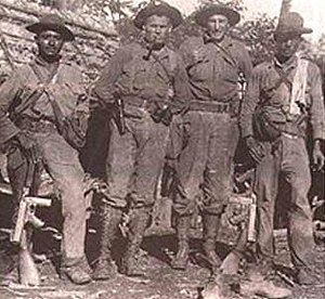 "Chesty Puller - First Lieutenant Lewis ""Chesty"" Puller (center left) and Sergeant William ""Ironman"" Lee (center right) and two Nicaraguan soldiers in 1931"