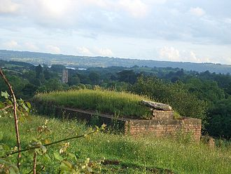 Chew Magna - World War II pill box in field north of Chew Magna with view southwards of the parish church and Chew Valley Lake (pictured 2011)