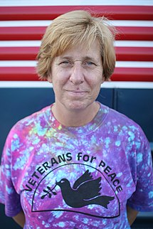 Cindy Sheehan wearing a Veterans for Peace t-shirt