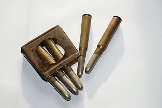 Magazine (firearms) - En-bloc clip and 8mm ammo for the Gewehr 88