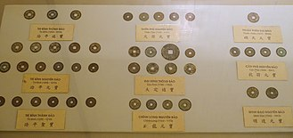 Vietnamese cash - Various Lý dynasty cash coins on display at the National Museum of Vietnamese History, Hanoi.