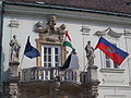 Columned, ornated gate and wrought iron balcony. Székesfehérvár Town Hall. Listed ID 3915. City Coat of Arms relief. Allegorical statues 'Justitia and Prudentia'. Or 'Truth and Wisdom'. - Városház Sq.JPG