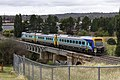 CountryLink Xplorer crossing the Queanbeyan River Railway Bridge.jpg