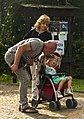 Couple with child in stroller on Stations of the Cross walkway, Esino Lario.jpg
