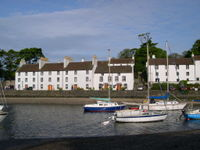 The village harbour at Cramond, with 18th century mill workers' housing in the background.