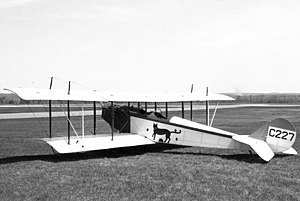 "Canadian English - A Canadian-built Curtiss JN-4C ""Canuck"" training biplane of 1918, with a differing vertical tail to the original U.S. version"