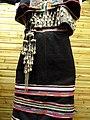 Dai woman cross-stitched, silver-ornamented dress detail - Yunnan Nationalities Museum - DSC04257.JPG