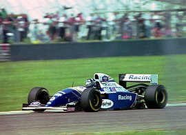 Damon Hill - Williams FW16 at the 1994 British Grand Prix (32541472155).jpg