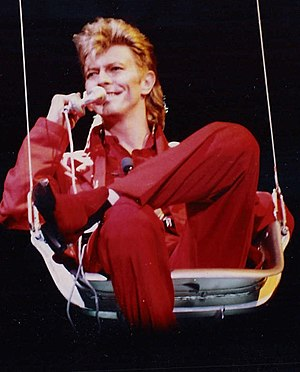 "Glass Spider Tour - David Bowie being lowered from the spider set's ceiling, to the opening song ""Glass Spider"" at Rock am Ring – 7 June 1987"
