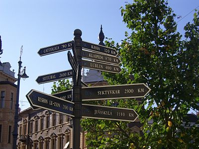 A signpost with distances to Debrecen's twin towns