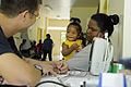 Defense.gov News Photo 100728-N-7280V-355 - U.S. Navy Ensign Neil Petersen assigned to U.S. Naval Hospital Guam records vitals for a toddler patient at the Southern Community Health Center.jpg