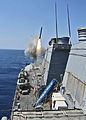 Defense.gov News Photo 110329-N-3396H-001 - The guided-missile destroyer USS Barry DDG 52 launches a Tomahawk cruise missile to support Joint Task Force Odyssey Dawn in the Mediterranean Sea.jpg