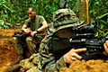 Defense.gov News Photo 110611-M-EV637-017 - U.S. Marine Corps Lance Cpl. Michael Reed right assigned to 2nd Squad 2nd Platoon Landing Force Company provides security with an M16A4 rifle.jpg