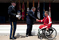 Defense.gov News Photo 120625-D-TT977-102 - Secretary of Defense Leon E. Panetta congratulates U.S. Marine Corps Lance Cpl. Ronald Sullivan at the 2012 Warrior Games Recognition Ceremony in the.jpg