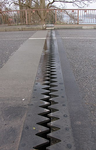 Thermal expansion - Expansion joint in a road bridge used to avoid damage from thermal expansion.