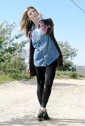 Leggings - A woman wearing black leggings.