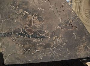 Rebellion of the Seven States - Wall fragment from a Chinese tomb, with an incised relief decoration showing a hunting scene with mounted archery, Han dynasty (202 BC - 220 AD) National Museum of Oriental Art, Rome