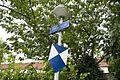 Door de bewoners zelf gemaakt blauw schildje en vast gemaakt onder een straatnaambord Maarland - Rotterdam - 20528198 - RCE.jpg