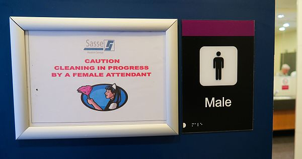 A note at the male public toilet in Edinburgh Airport about the fact that female cleaners might work there. EdinburghAirport00.jpg