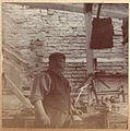 Edwardian blackmith (or other trade) in a workshop (6631187077).jpg