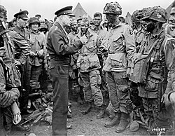 Eisenhower speaks with U.S. paratroops of the 502d Parachute Infantry Regiment, 101st Airborne Division on the evening of June 5, 1944.