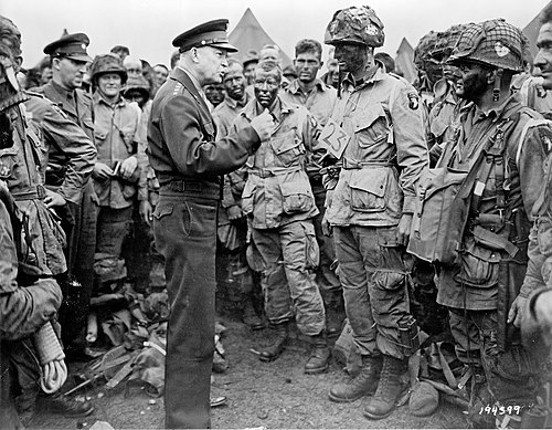 General Eisenhower speaks with members of the 101st Airborne Division on the evening of June 5, 1944 Eisenhower d-day.jpg