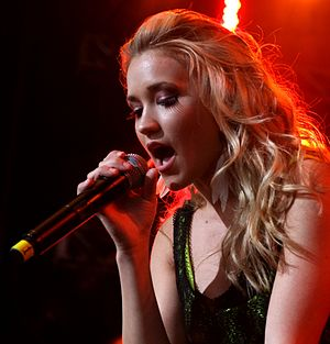 Emily Osment - Osment performing live at KISS concert in May 2010
