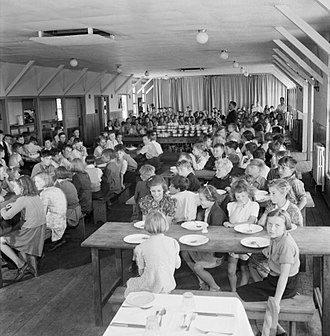 Evacuations of civilians in Britain during World War II - Marchant's Hill School was an evacuation camp of wooden buildings built at Hindhead in Surrey. This is the dining hall in use in 1944.