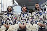 Expedition 48 backup crew members in front of the Soyuz TMA spacecraft mock-up in Star City, Russia.jpg