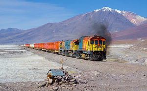 Ferrocarril de Antofagasta a Bolivia - EMD GR12 2402, EMD/Clyde GL26C-2 2010 and EMD/Clyde GL26C-2 2005 crossing the Salar de Ascotán, with Cerro del Azufre in the background